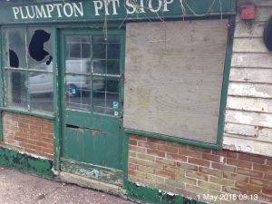 Derelict Plumpton Pit Stop with boarded window