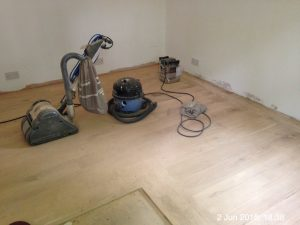 Plumpton Pit Stop fully sanding the 22mm oak parquet flooring