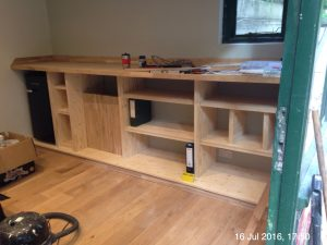 Plumpton Pit Stop oak worktop and structural plywood shelving and draws.